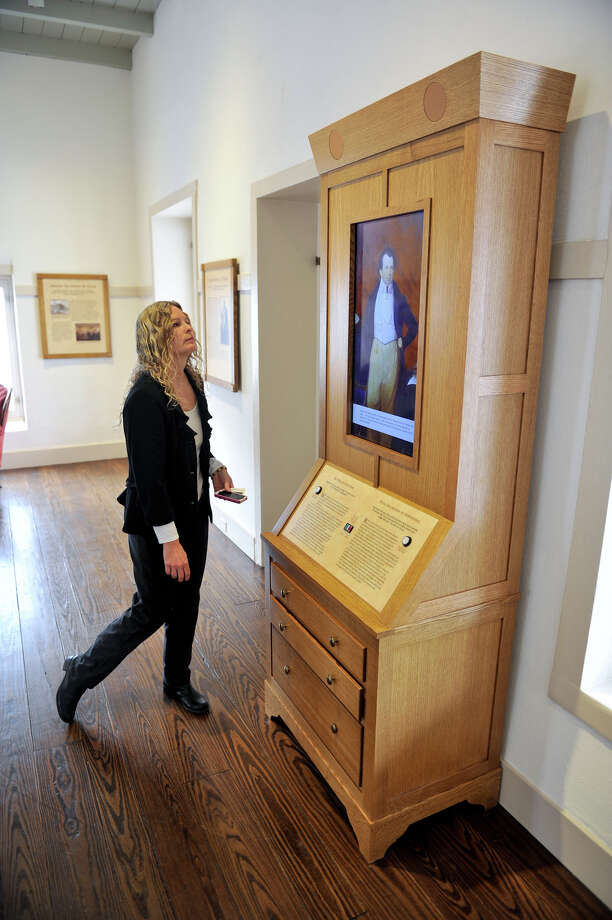 Casa Navarro State Historic site manager Maureen Brown looks over one of the interactive exhibits at the downtown location. Photo: ROBIN JERSTAD, SPECIAL TO THE EXPRESS-NEWS / SAN ANTONIO EXPRESS-NEWS