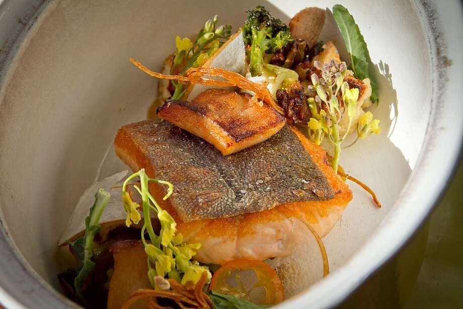 The arctic char is served with caramelized cauliflower and king trumpet mushrooms. Photo: John Storey