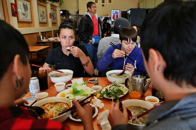 Nova Ray (middle left) and Ariel Leighton (middle right) having pho at PPQ Beef Noodle House in San Francisco, Calif., on Friday, February 10, 2012. Photo: Liz Hafalia, The Chronicle