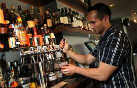 Jasper's Tap Room bar manager Kevin Diedrich pours a Negronis cocktail thatÕs stored in a barrel, similar to beer Tuesday February 21, 2012.