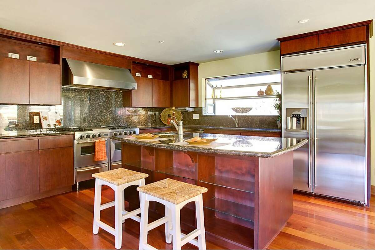 An upgraded chef's kitchen boasts granite countertops, a spacious island and cherry cabinetry, while another nice feature is the garden window.