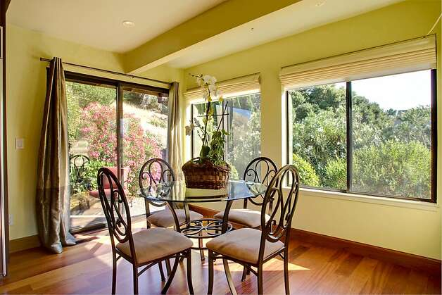 Adjacent to the kitchen are the bright and sunny breakfast room and a separate pantry. Photo: Jason Wells