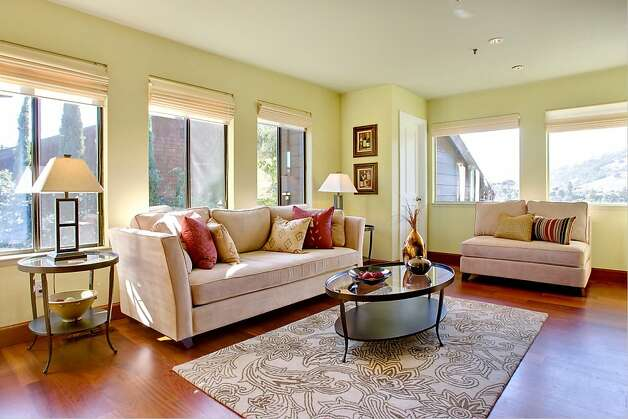 Large windows offer a view from the family room. Photo: Jason Wells