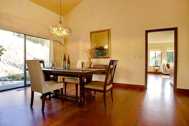 The open dining room offers sliding-door access to the rear patio for an al fresco dining option. Photo: Jason Wells