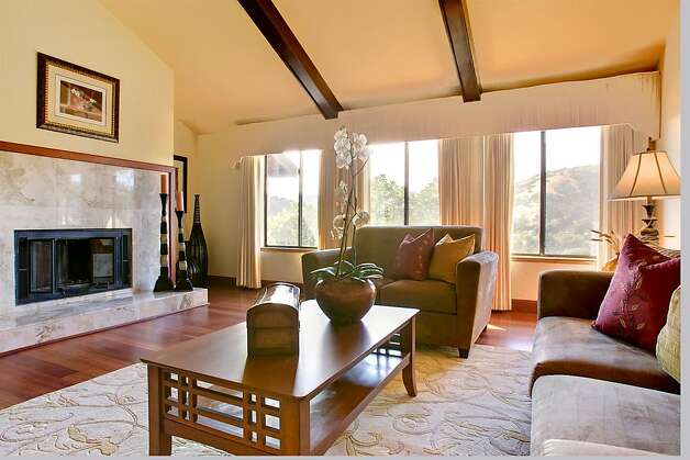 The living room has a large fireplace. Photo: Jason Wells