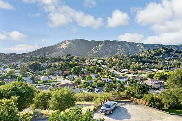 Sitting on over one-third of an acre, the secluded lot has expansive views of Lucas Valley and the surrounding woodlands, hills and mountains. Photo: Jason Wells