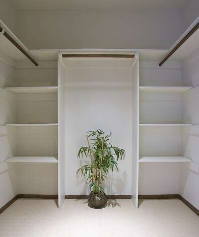The master suite includes a large walk-in closet with built-in organization. Photo: Jason Wells