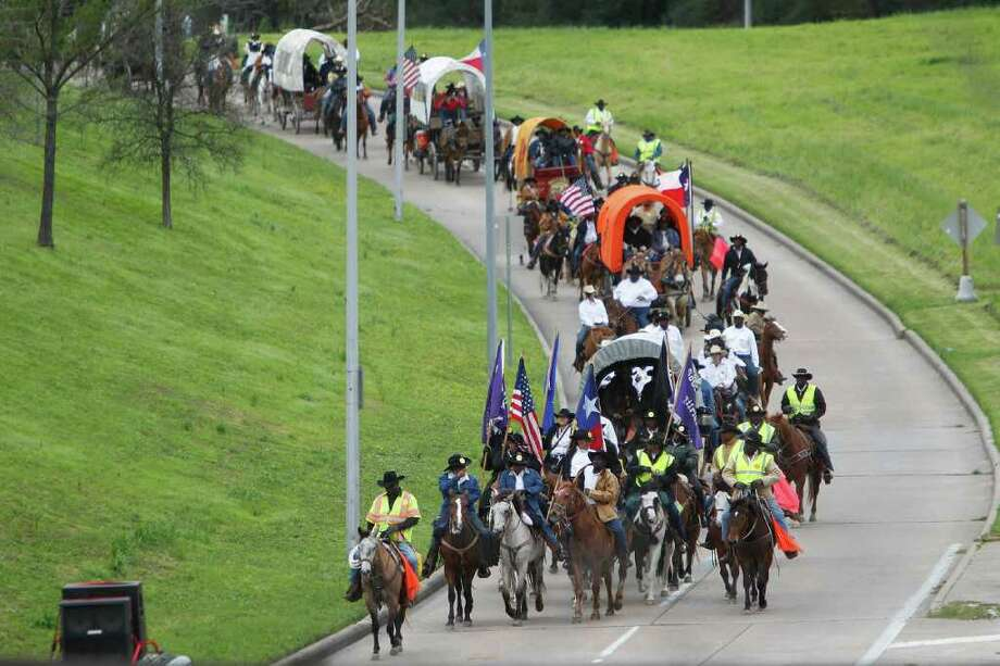 Trail Riders arrive at Memorial Park on Friday, Feb. 24, 2012, in Houston. Photo: Mayra Beltran, Houston Chronicle / © 2012 Houston Chronicle