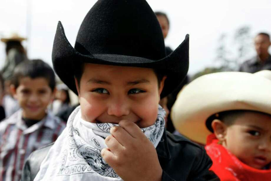 Jason Jasso, 5, waits with his classmates to meet trail riders and their horses. Photo: Johnny Hanson, Houston Chronicle / © 2012  Houston Chronicle