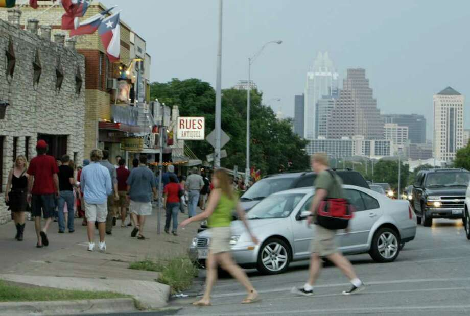 A street not just for cars: Angled parking and wide sidewalks on Austin's South Congress Ave. Photo: Kevin Fujii / Houston Chronicle