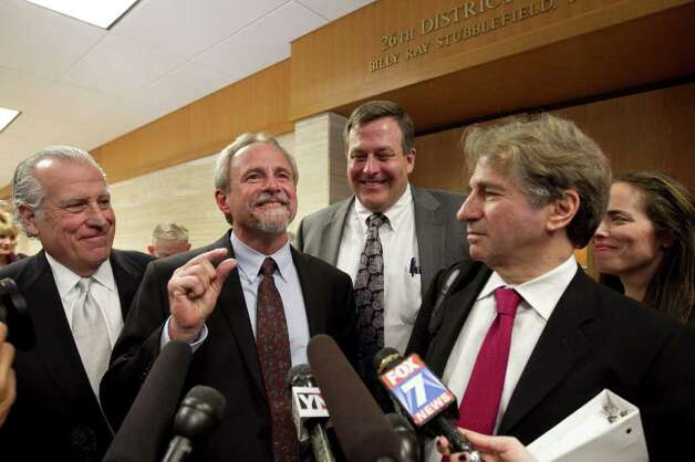 Michael Morton, second from left, and his legal team speak to the media after Judge Sid Harle ruled in favor of a court of inquiry for Judge Ken Anderson at the Williamson County Justice Center in Georgetown. Photo: Jay Janner / Austin American-Statesman