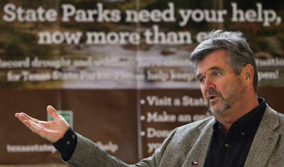 Scott Boruff, a Texas Parks and Wildlife Department official, talks about an appeal for financial help from the public for state parks during a meeting last year. Photo: Brett Coomer / © 2011 Houston Chronicle