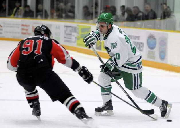 Danbury Whalers player, Matt Moffatt, right,  has possession of the puck while Sylvain Deschatelets tries to steal during a game against the Akwesasne Warriors at the Danbury Arena on Friday Feb. 24, 2012. Photo: Lisa Weir / The News-Times Freelance