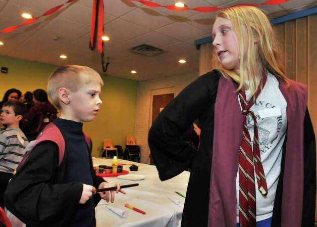 "David Waldin, left, 6, of Ballston Spa and in costume as ""Harry Potter"" and Kelly Donovan, 9, of Northville dressed as ""Hermoine"" play a game during a Harry Potter party at the Children?s Museum at Saratoga Friday Feb. 24, 2012.   (John Carl D'Annibale / Times Union) Photo: John Carl D'Annibale / 00016488A"