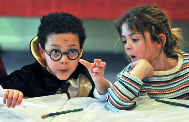 Six-year-olds Samuel LaMere, left, of Saratoga Springs and Ellie Tandlmayer of Rexford get into character during a Harry Potter party at the Children?s Museum at Saratoga Friday Feb. 24, 2012.   (John Carl D'Annibale / Times Union) Photo: John Carl D'Annibale / 00016488A