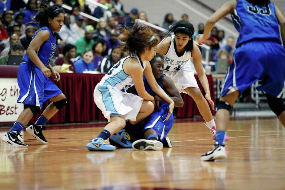 Clear Springs forward, Aaliyah Brown, 20, and Elsik guard Jazmine Ocanas, 23, fight for the ball, during the Class 5A, Region III semifinal girls high school basketball game between Elsik High School and Clear Springs High School, Friday, February 24, 2012 at the Aldine Campbell Center in Houston, Texas. Elsik won 43 - 40, to on to the region final on Saturday. Photo: TODD SPOTH, For The Chronicle / Todd Spoth
