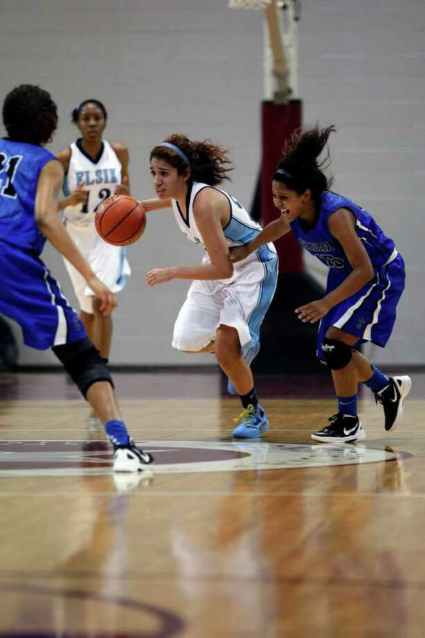 Feb. 24: Elsik 43, Clear Springs 40 - Elsik guard Jazmine Ocanas takes the ball down court after making a steal during the Class 5A Region III semifinal against Clear Springs. Elsik advances to Saturday's Region III-5A final. Photo: TODD SPOTH, For The Chronicle / Todd Spoth