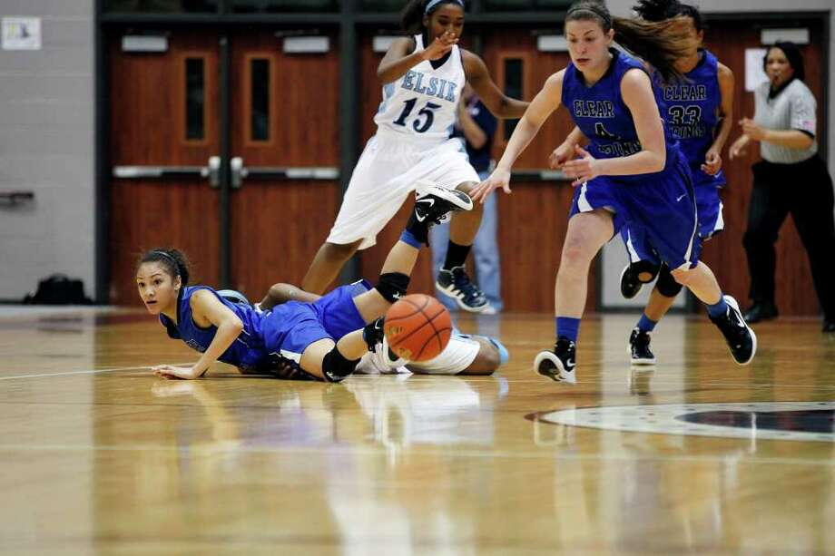Clear Springs' Paige Tippet, 4, hustles to recover a loose ball, during the Class 5A, Region III semifinal girls high school basketball game between Elsik High School and Clear Springs High School, Friday, February 24, 2012 at the Aldine Campbell Center in Houston, Texas. Elsik won 43 - 40, to on to the region final on Saturday. Photo: TODD SPOTH, For The Chronicle / Todd Spoth