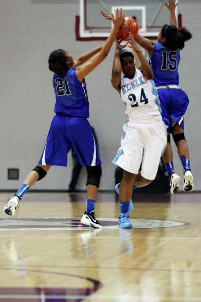 Elsik forward, Crystal Porter, 24, loses control of the ball during a double teaming by Clear Spring