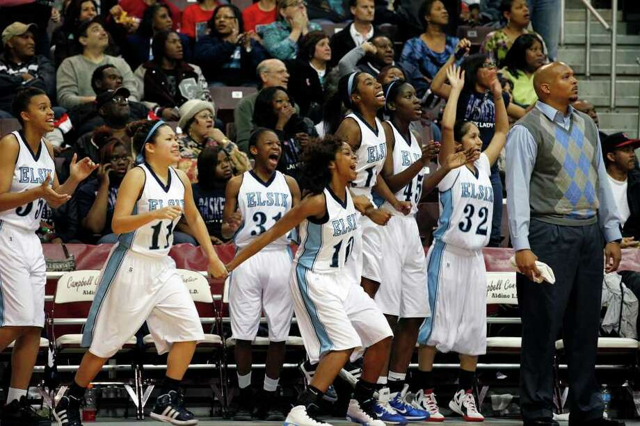 The Elsik bench cheers after the Class 5A, Region III semifinal girls high school basketball game between Elsik High School and Clear Springs High School, Friday, February 24, 2012 at the Aldine Campbell Center in Houston, Texas. Elsik won 43 - 40, to on to the region final on Saturday. Photo: TODD SPOTH, For The Chronicle / Todd Spoth