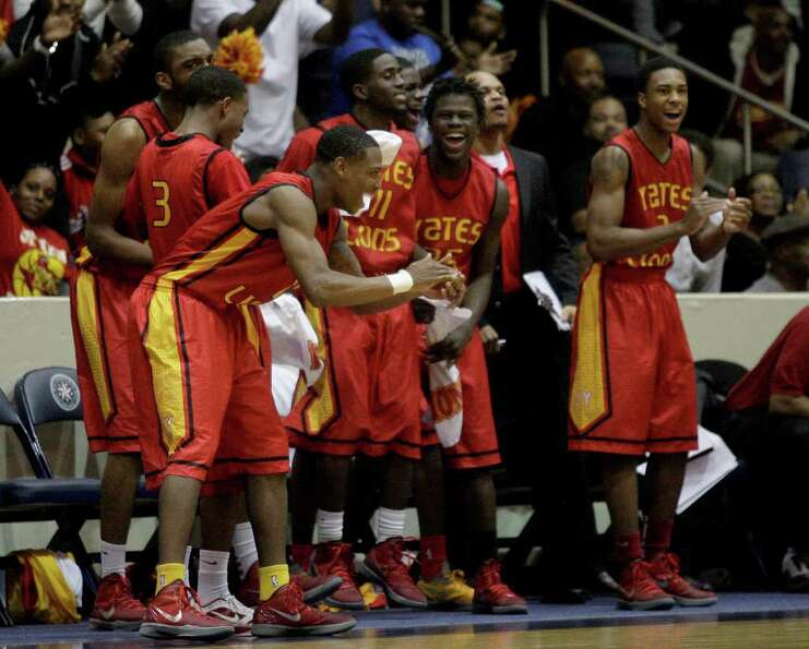 2/24/12: The Yates Lions celebrate a dunk over the Manvel Mavericks in a mens high school playoff  b