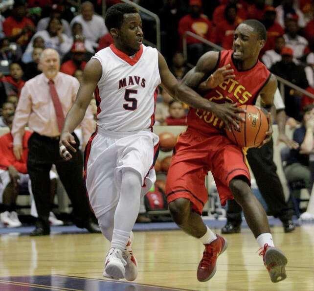 2/24/12: Darrion Martin #23 of Yates Lions makes a move around Jonovan Williams  #5 of Manvel Maveri