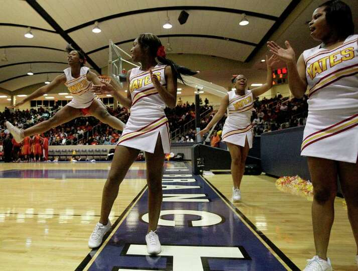 2/24/12: The Yates Lions cheerleaders cheer during a Manvel Mavericks timeout in a mens high school