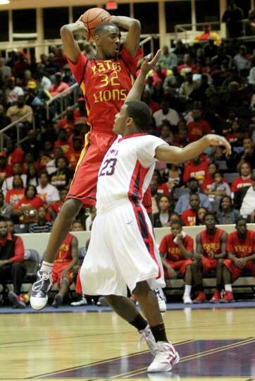 2/24/12: Clyde Santee  #32 of Yates Lions goes over Julian Walker #23 of Manvel Mavericks for a rebo