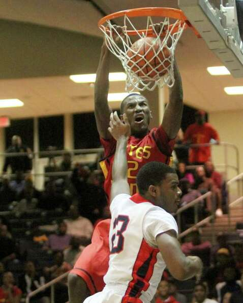 2/24/12: Melvin Swift #12 of Yates Lions dunks over Julian Walker #23 of Manvel Mavericks for a rebo