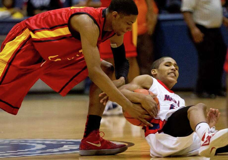 Feb. 24: Yates 99, Manvel 58 -Yates' Chris Wells, left, and Manvel's Jalen Hatch fight for a loose ball during Friday's game at Coleman Coliseum. Photo: Thomas B. Shea, For The Chronicle / © 2011 Thomas B. Shea