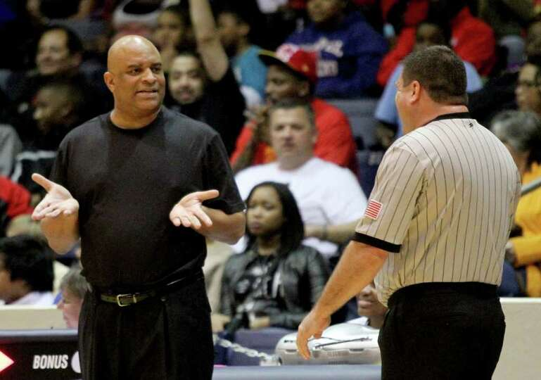 2/24/12:  Head coach Greg Wise of Yates Lions argues a call with a referee while Yates plays agains