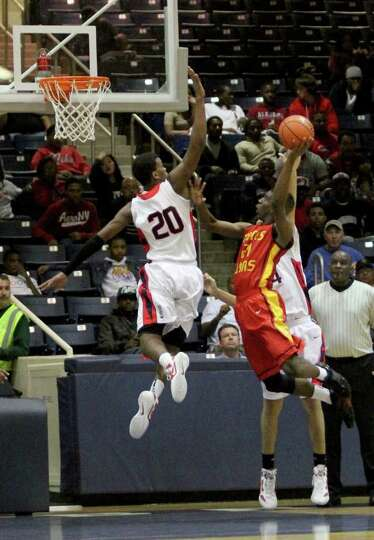 2/24/12: Damion Dotson #21 of Yates Lions scores over Terry Allen #20 of Manvel Mavericks in a mens