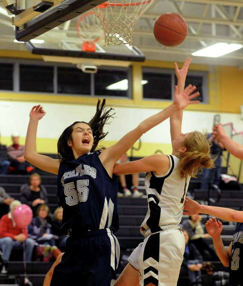 Staples' Maddie Schemel, left, tries to block a Trumbull shot earlier in the year. Schemel and her teammates face Hall in West Hartford Monday in the first round of the Class LL playoffs. Photo: Christian Abraham, Christian Abraham/Staff Photographer / Connecticut Post