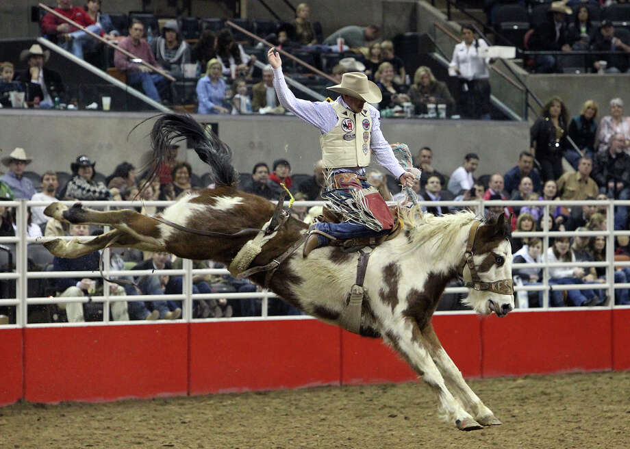 Chet Johnson rides Alley Lights during the Saddle Bronc Riding competition at the 2012 San Antonio Stock Show & Rodeo on Friday, Feb. 24, 2012. Kin Man Hui/San Antonio Express-News Photo: Kin Man Hui, SAN ANTONIO EXPRESS-NEWS / ©2012 SAN ANTONIO EXPRESS-NEWS