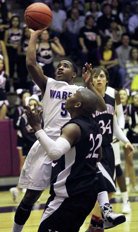 Marcus Keene scores all 11 of Warren's fourth-quarter points, including the game-winning shot with 1.4 seconds left, giving the Warriors a thrilling 77-76 victory over Churchill. Photo: TOM REEL, San Antonio Express-News / San Antonio Express-News