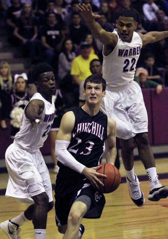 Chargers guard Scott Mammel gets into the lane against Demarcus Garcia (left) and Jordan Corona as Warren beats Churchill 77-76 in playoff action at the Alamo Convocation Center on Friday, Feb. 24, 2012. Photo: TOM REEL, San Antonio Express-News / San Antonio Express-News