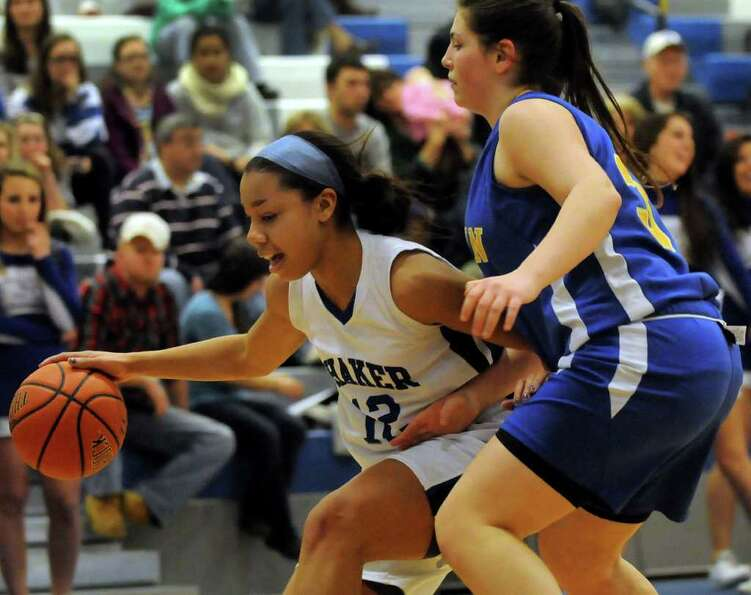 Shaker's Madison Rowland (12), left, controls the ball as Bishop Maginn's Caitlin Hupe (32) defends