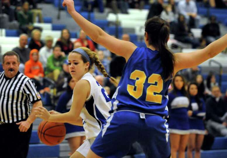 Shaker's Madeline Devine (25), left, controls the ball as Bishop Maginn's Caitlin Hupe (32) defends