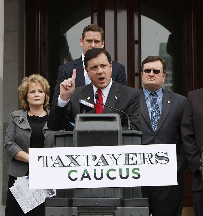 The Taxpayers Caucus is comprised of GOP lawmakers from the Assembly and Senate, including Assemblywoman Shannon Grove, R-Bakersfield, left, Sen. Tony Strickland, R-Thousand Oaks, background center and Assemblyman Kevin Jeffries, R-Lake Elsinore, right. Photo: Rich Pedroncelli, AP