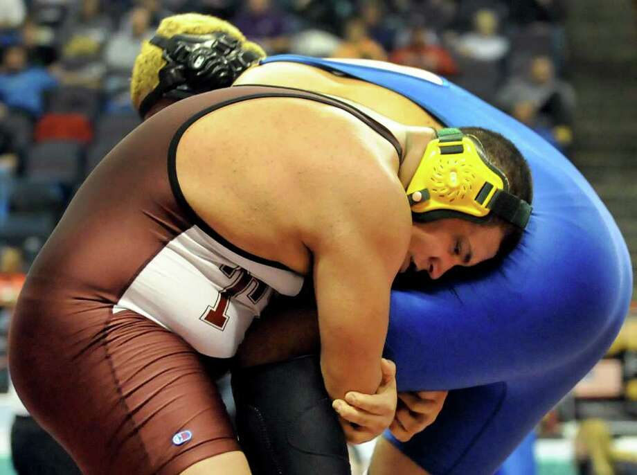 Ravena's Alex Soutiere, center, grapples with Vernon's Brian Ervin in the Division II quarterfinals of the State Wrestling Tournament on Friday, Feb. 24, 2012, at Times Union Center in Albany, N.Y. (Cindy Schultz / Times Union) Photo: Cindy Schultz / 00016193B