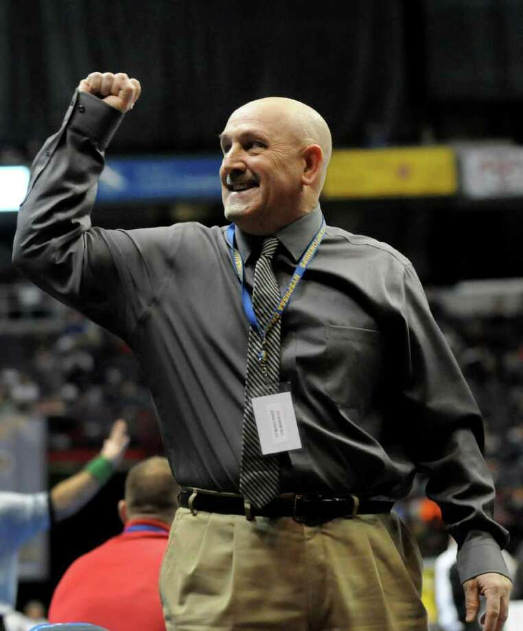 Duanesburg's assistant coach John Conway salutes the crowd when Curt Rowley wins at 132 pounds in the Division II quarterfinals of the State Wrestling Tournament on Friday, Feb. 24, 2012, at Times Union Center in Albany, N.Y. (Cindy Schultz / Times Union) Photo: Cindy Schultz / 00016193B