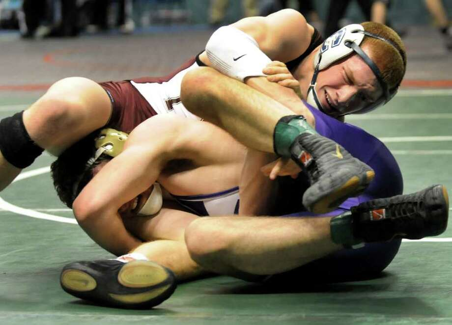 Columbia's  Evan Wallace grapples Rush-Henrietta's John Northrup at 145 pounds in the Division I quarterfinals of the State Wrestling Tournament on Friday, Feb. 24, 2012, at Times Union Center in Albany, N.Y. Wallace wins. (Cindy Schultz / Times Union) Photo: Cindy Schultz / 00016193B
