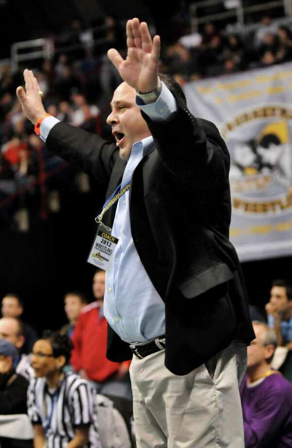 Columbia's coach Anthony Servidone cheers as Evan Wallace wins at 145 pounds in the Division I quarterfinals of the State Wrestling Tournament on Friday, Feb. 24, 2012, at Times Union Center in Albany, N.Y. (Cindy Schultz / Times Union) Photo: Cindy Schultz / 00016193B