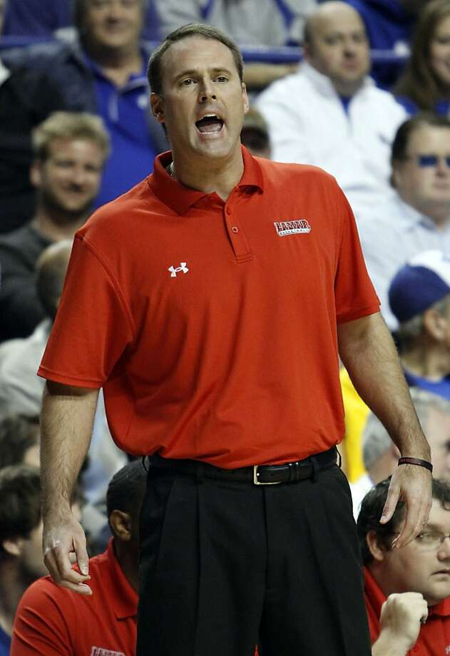 FILE - In this Dec. 28, 2011, file photo, Lamar head coach Pat Knight shouts instructions to his team during the first half of an NCAA college basketball game against Kentucky in Lexington, Ky. Lamar coach Pat Knight has torn into his players in a way that might remind some of his father.  On Wednesday night, Feb. 22, 2012, after his team lost 62-52 to Stephen F. Austin, the younger and usually more subdued Knight pulled no punches in an extended rant that prompted comparisons to Bob Knight, his dad and a legendary coach known for his fiery temper. (AP Photo/James Crisp, File) Photo: James Crisp, Associated Press