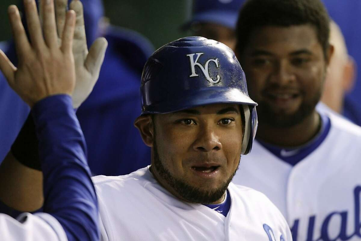 KANSAS CITY, MO - SEPTEMBER 15: Melky Cabrera #53 of the Kansas City Royals celebrates his home run in the first inning with teammates during a game against the Chicago White Sox at Kauffman Stadium on September 15, 2011 in Kansas City, Missouri. (Photo by Ed Zurga/Getty Images) KANSAS CITY, MO - SEPTEMBER 15: Melky Cabrera #53 of the Kansas City Royals celebrates his home run in the first inning with teammates during a game against the Chicago White Sox at Kauffman Stadium on September 15, 2011 in Kansas City, Missouri. (Photo by Ed Zurga/Getty Images)