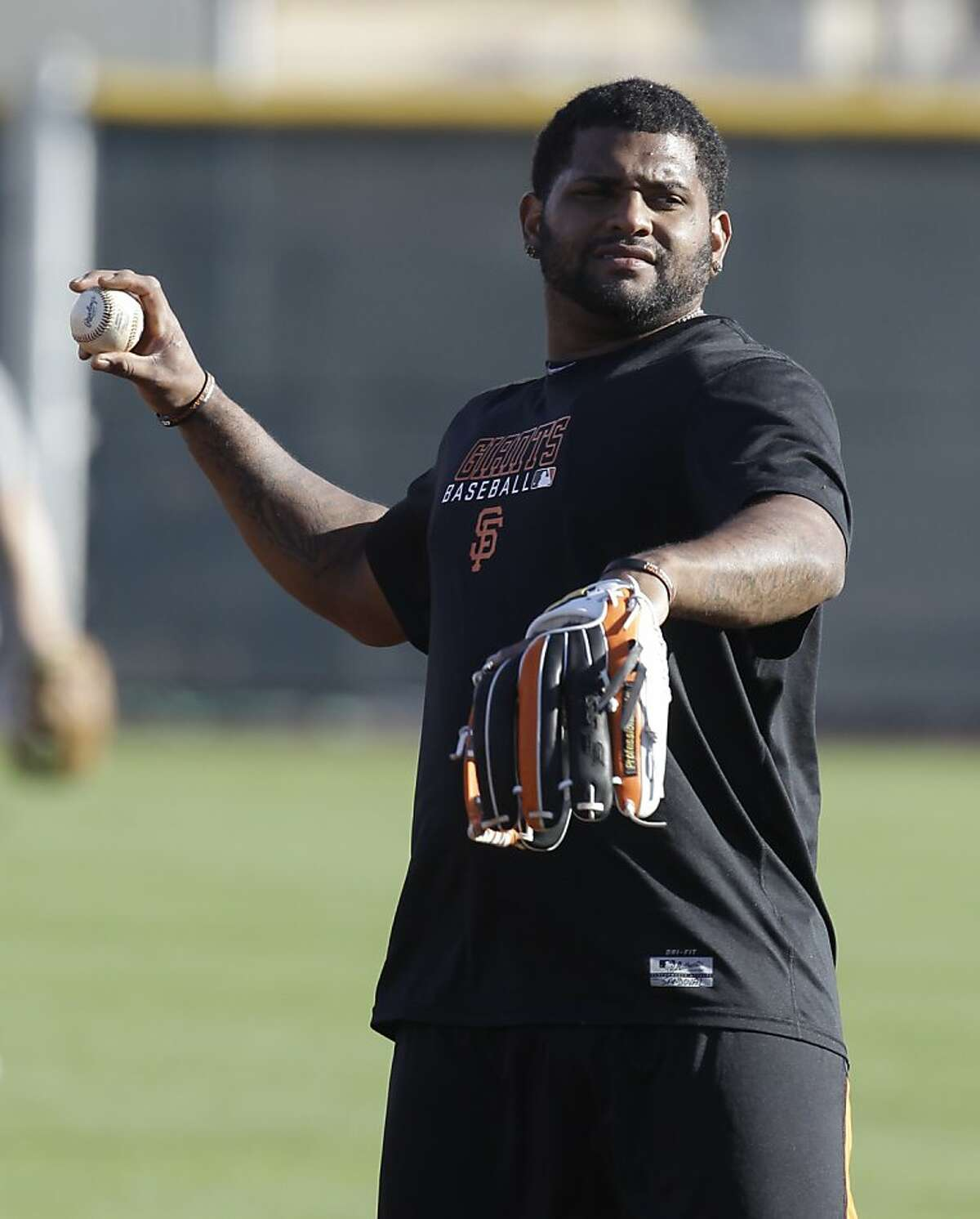 San Francisco Giants' Pablo Sandoval reacts while taking infield practice during a spring training baseball workout Wednesday, Feb. 22, 2012, in Scottsdale, Ariz. (AP Photo/Darron Cummings)