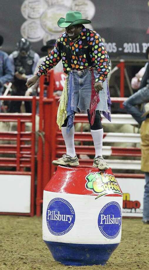 Barrel man Leon Coffee performs a dance atop his barrel during a break in the Bull Riding competition at the 2012 San Antonio Stock Show & Rodeo on Friday, Feb. 24, 2012. Kin Man Hui/San Antonio Express-News Photo: Kin Man Hui, SAN ANTONIO EXPRESS-NEWS / ©2012 SAN ANTONIO EXPRESS-NEWS