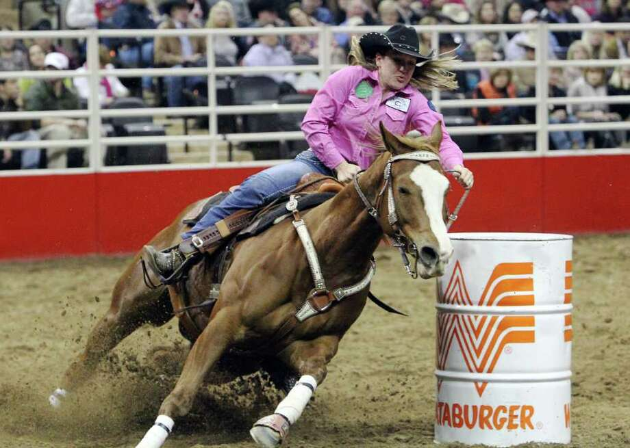 Cassie Moseley gets her horse around the third turn during the Barrel Racing competition at the 2012 San Antonio Stock Show & Rodeo on Friday, Feb. 24, 2012. Kin Man Hui/San Antonio Express-News Photo: Kin Man Hui, SAN ANTONIO EXPRESS-NEWS / ©2012 SAN ANTONIO EXPRESS-NEWS