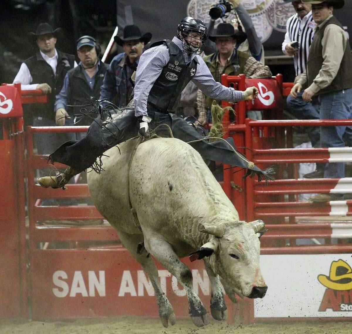 Cody Teel rides Sooner Shaker during the Bull Riding competition at the 2012 San Antonio Stock Show & Rodeo on Friday, Feb. 24, 2012.