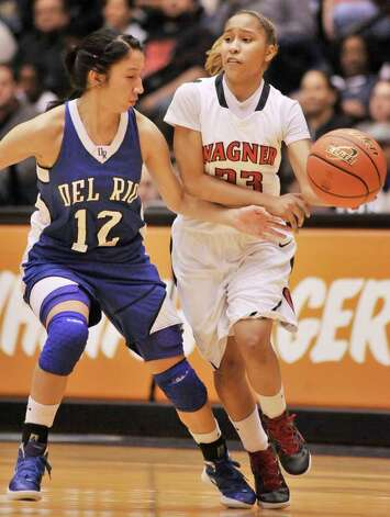 Wagner's Adriane Davis (right) drives around Del Rio's Jazmin Torres during the first half of their playoff game on Friday, Feb. 24, 2012, at UTSA. Wagner won 58-46. Photo: Darren Abate, For The Express-News